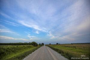 landscape road grasses fence clouds