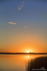 sunset grasses landscapes waterscape orange