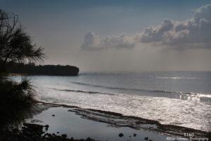 waterscape landscape beach shore sand rocks clouds trees hawaii