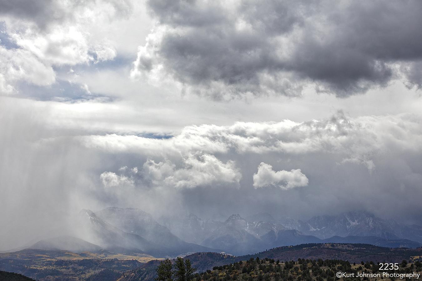 landscape clouds desert storm mountains