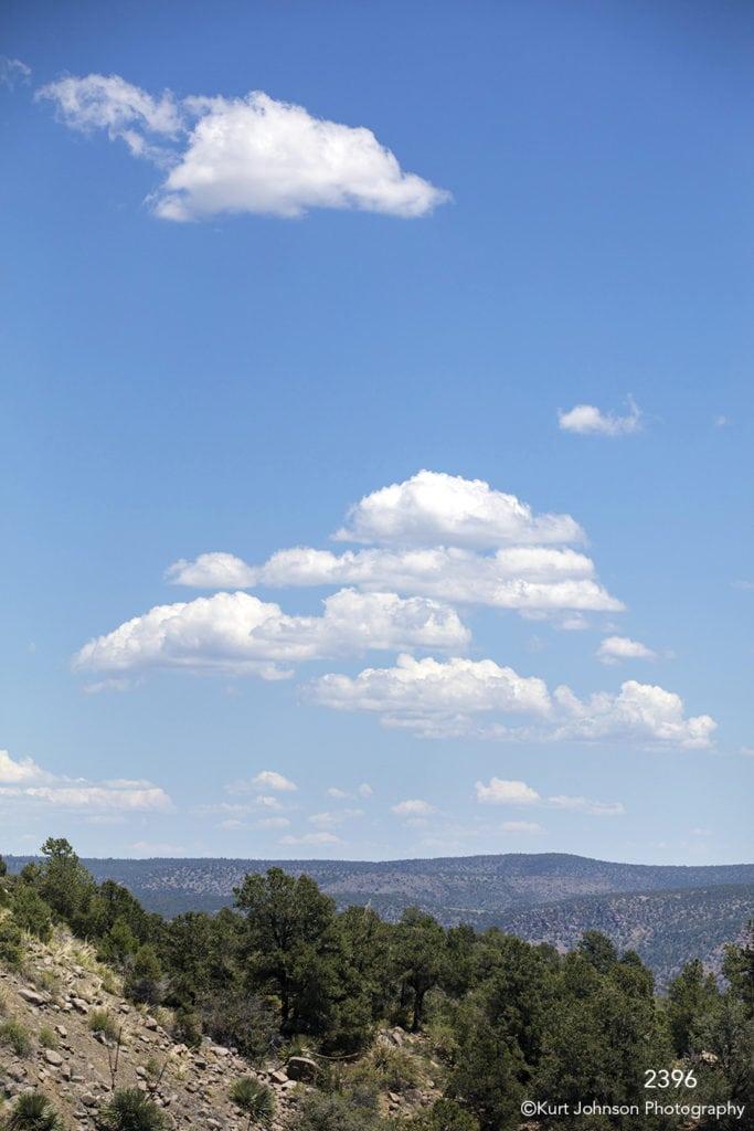 landscape desert clouds trees mountains