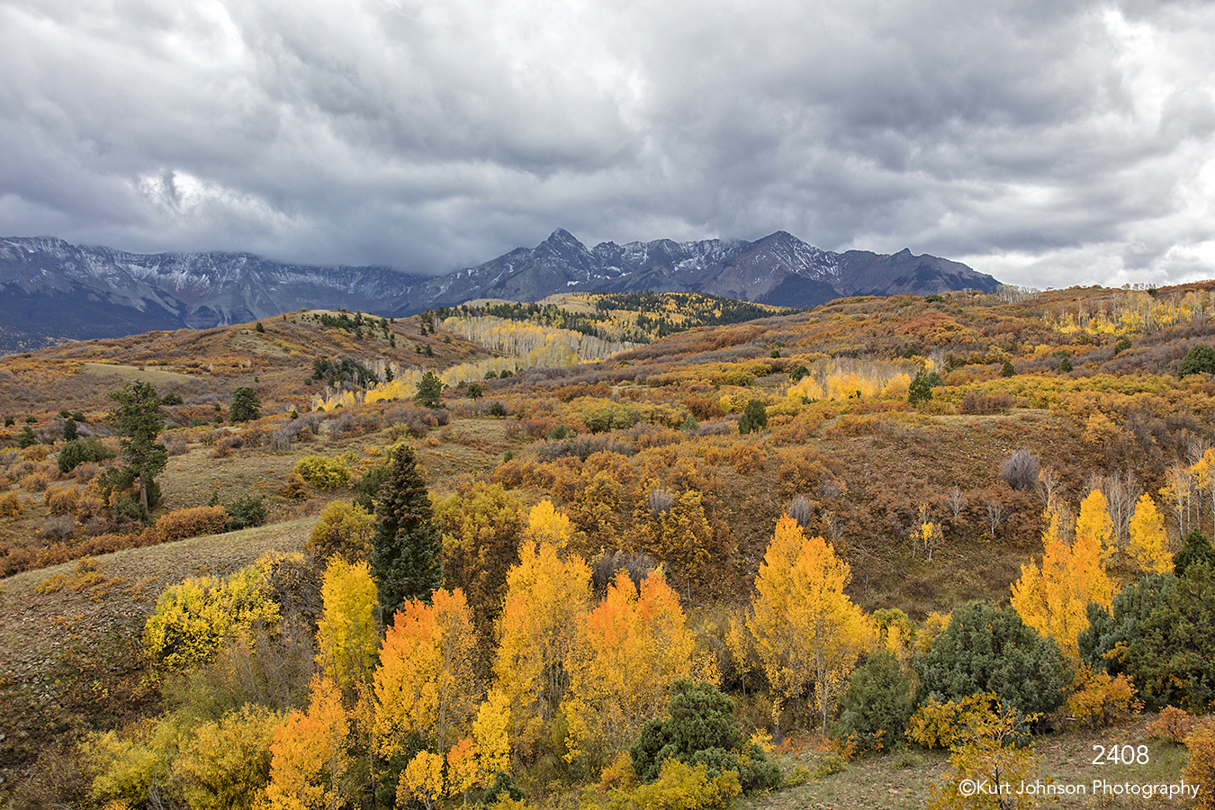 landscape fall color mountains clouds yellow gold birch trees