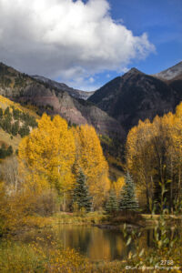 landscape mountains clouds yellow gold fall color pond forest trees colorado