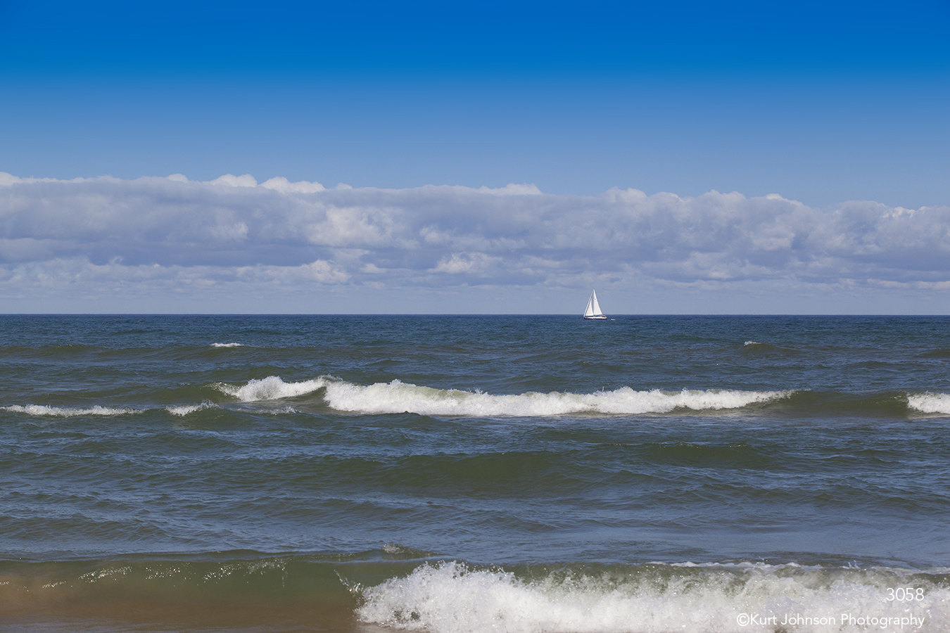 waterscape ocean water waves sailboat clouds sky blue