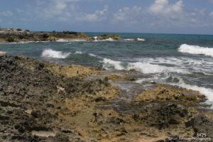 waterscape landscape shore beach ocean sand waves blue clouds
