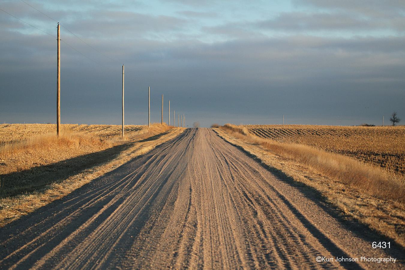 landscape dirt road fields clouds earthtones brown