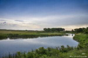 landscape river waterscape green grasses blue sky sunset