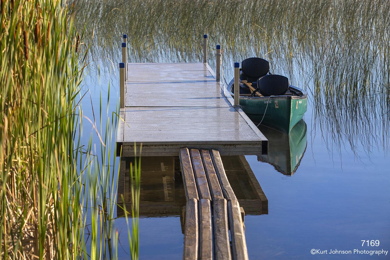 waterscape landscape water dock canoe grasses green blue pond
