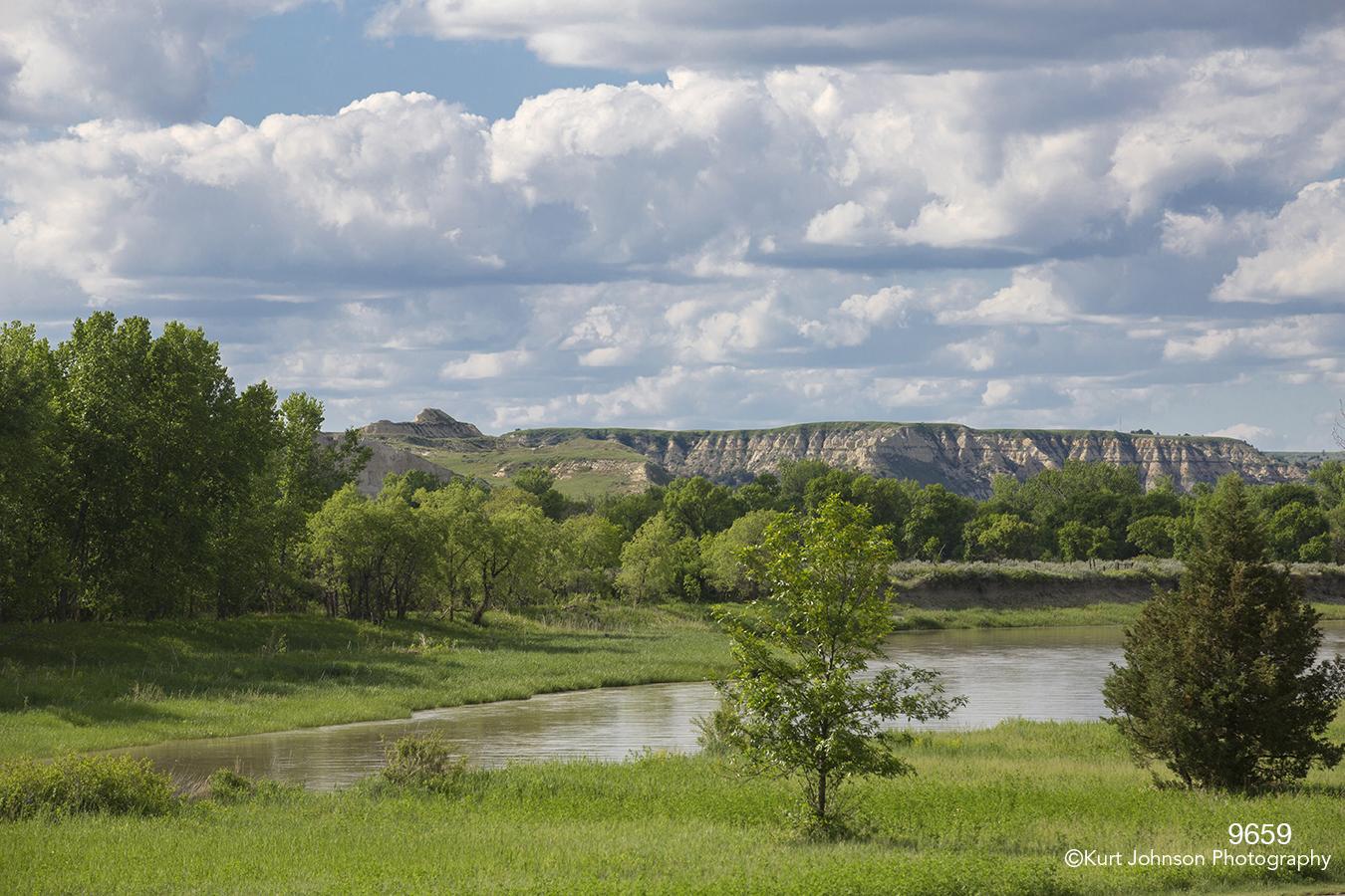 landscape river water mountains grasses trees clouds dakota
