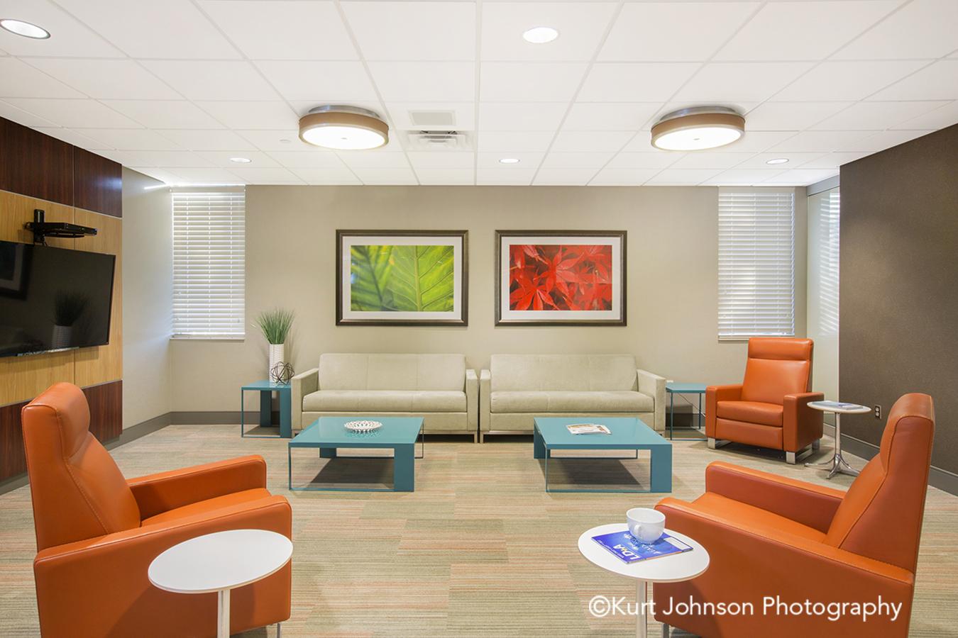 Bryan Health Nebraska NE healthcare framed art installation office lounge area waiting furniture interiors red green leaves orange