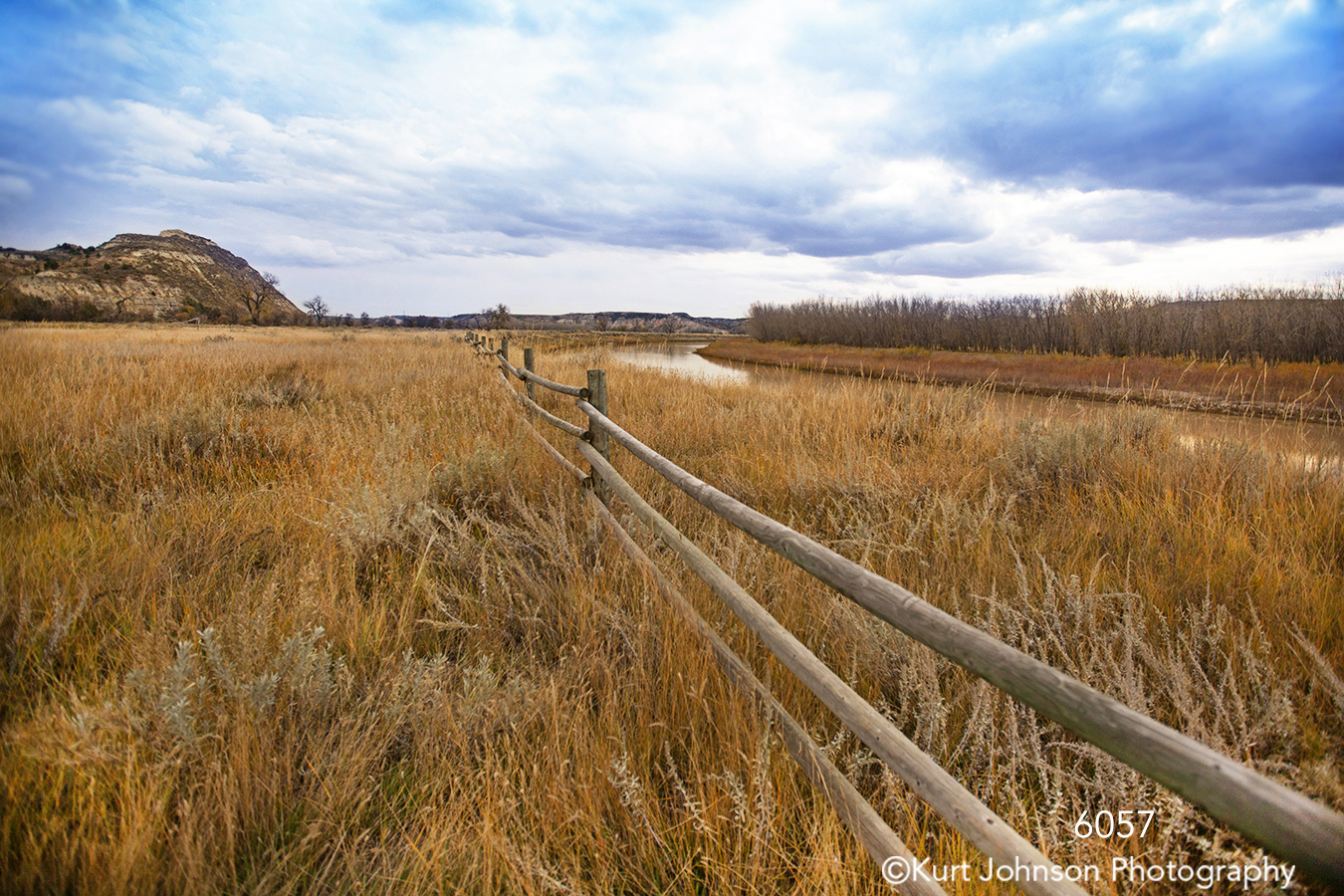 landscape grasses fence clouds river trees earthtones mountains dakota midwest