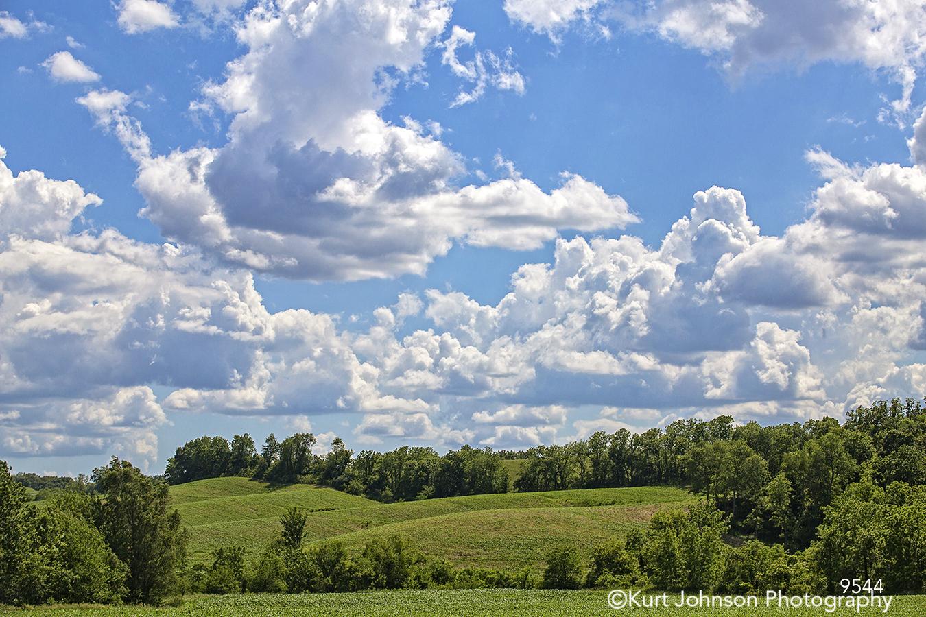 landscape clouds blue sky green fields trees