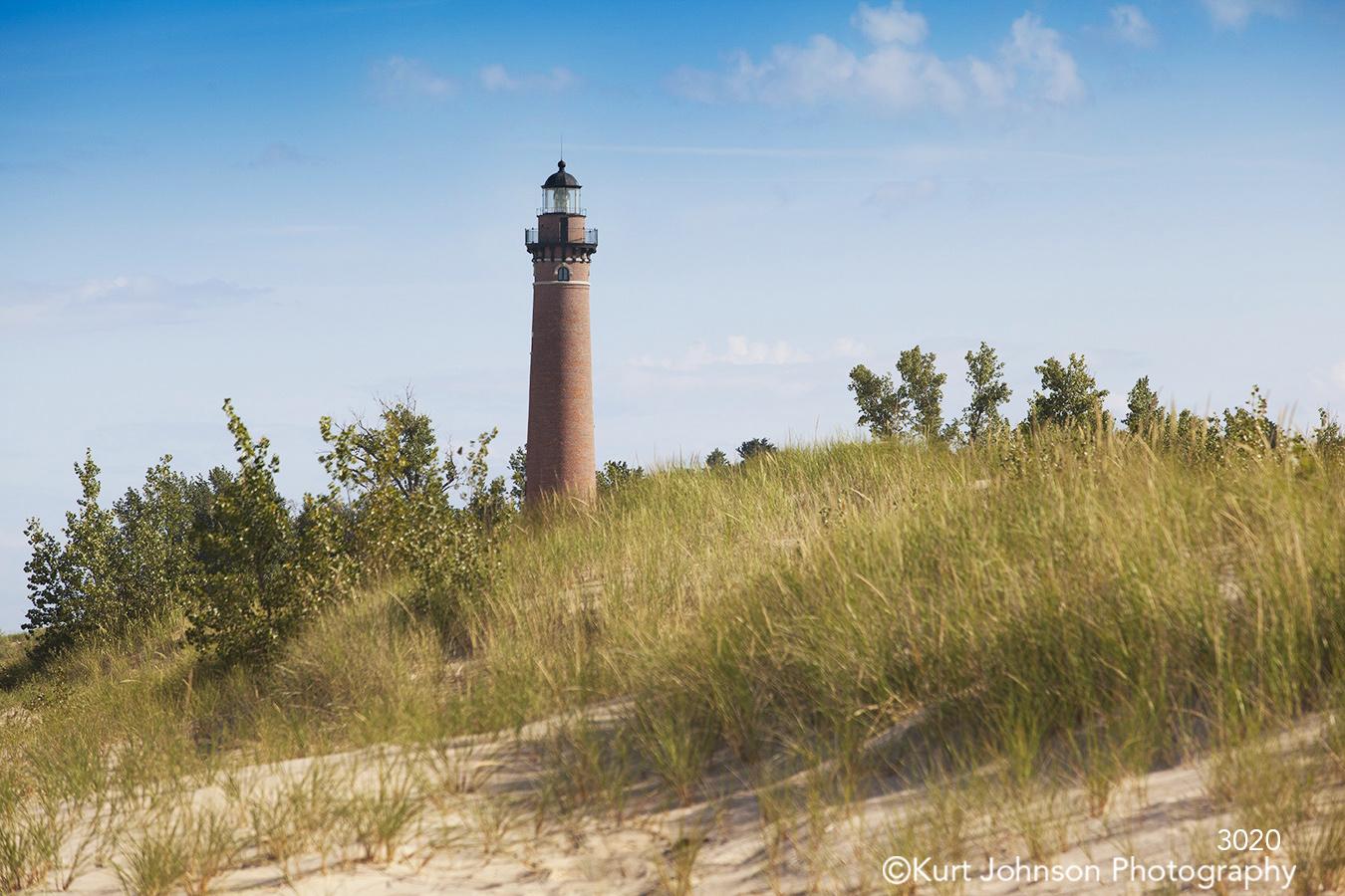 landscape beach sand shore grasses lighthouse sky great lakes
