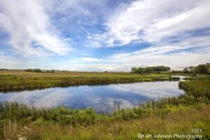 landscape lake grasses sky clouds