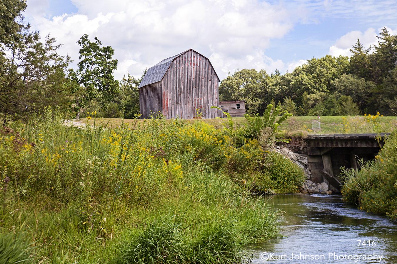 landscape waterscape stream water barn grasses green rural nebraska