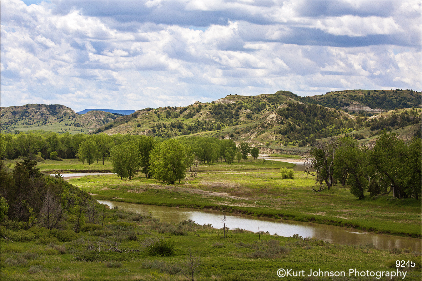 landscape water river mountains green grasses trees dakota clouds
