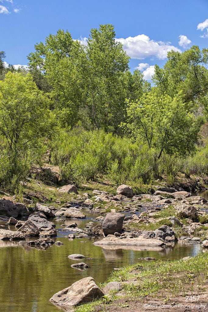 landscape southwest desert trees clouds river rocks