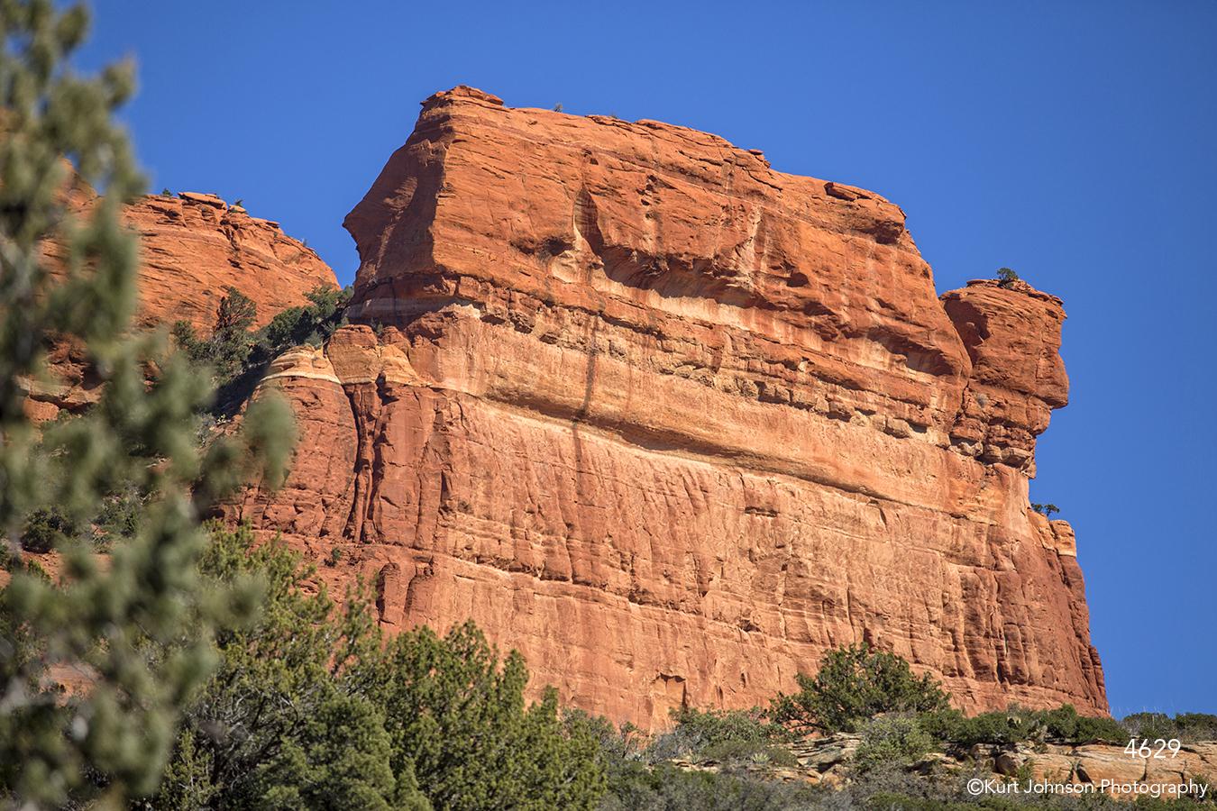 southwest cliffs rocks desert trees green orange