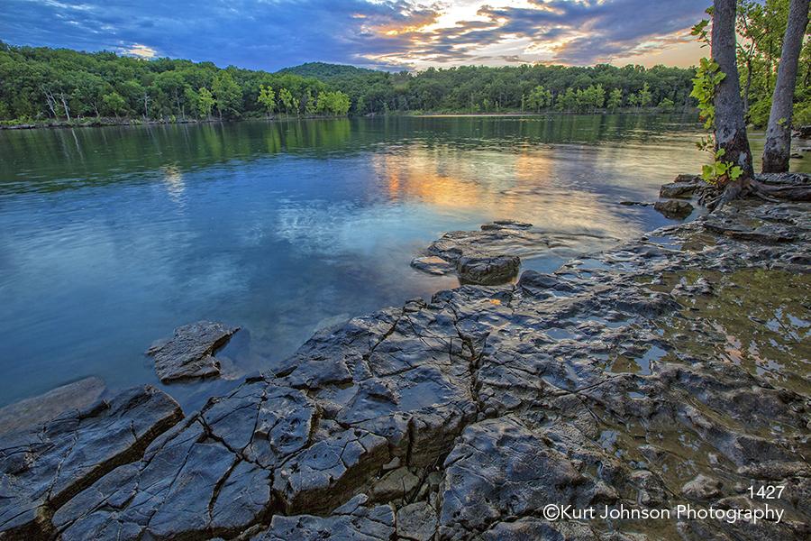 water rocks sunset trees lake