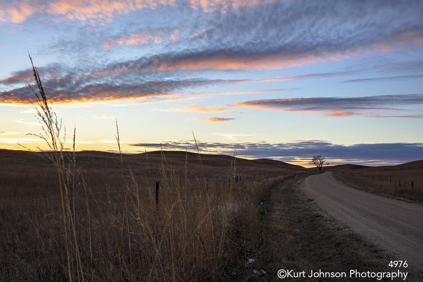 road path sunset landscape purple pink blue sky clouds field wheat travel