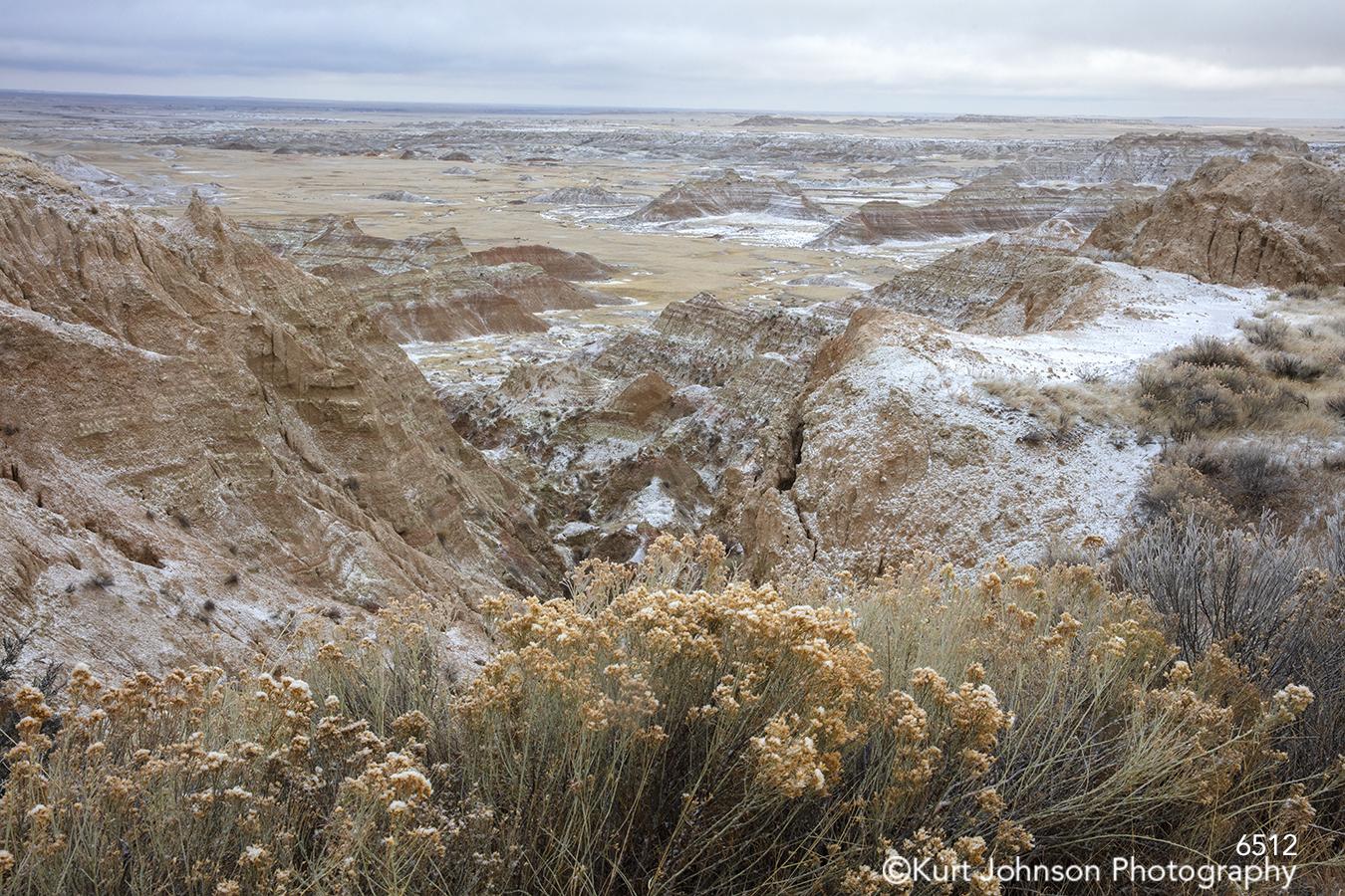 Badlands South Dakota Dakotas mountains grass grasses landscape brown tan beige snow winter yellow