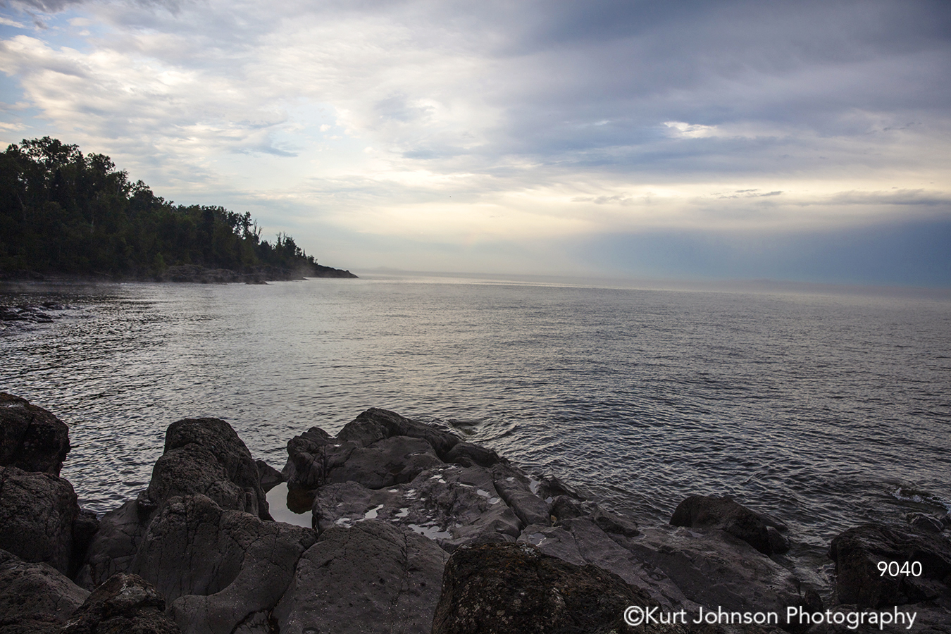 ocean water waves rock stone gray blue shore waterscape horizon clouds