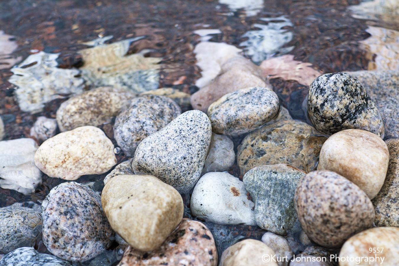 water rocks gray tan beige stone stones pebbles waves river stream