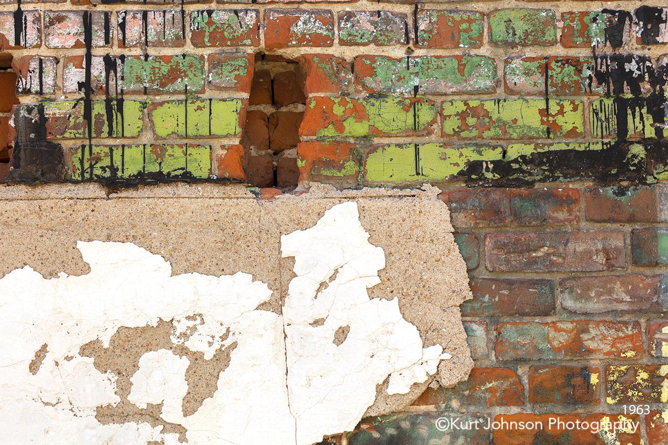 brick wall orange green turquoise paint peeling texture pattern urban