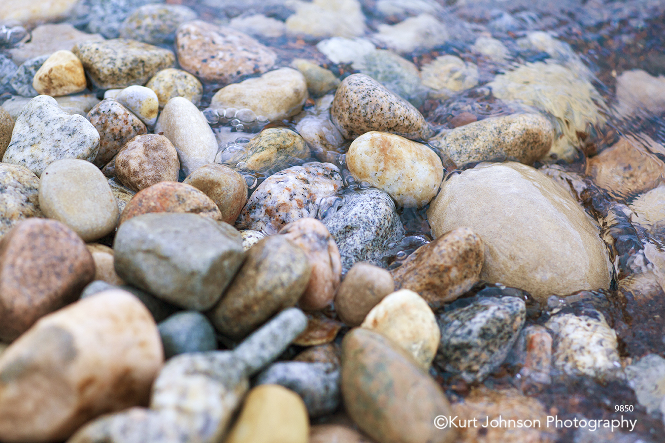 rocks water beige brown gray stone waterscape detail close up pattern texture
