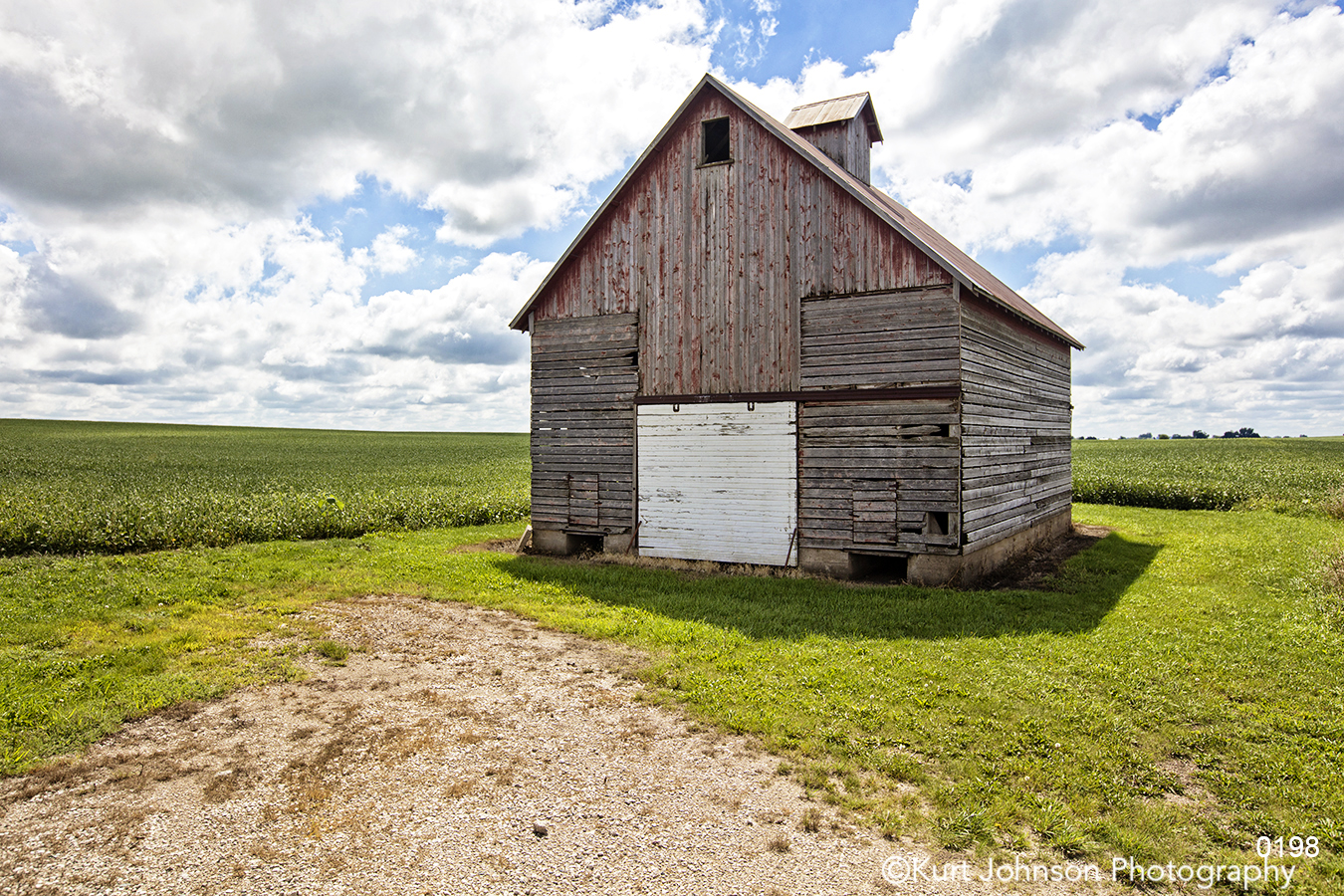 midwest blue sky brown barn green field farm country grass clouds