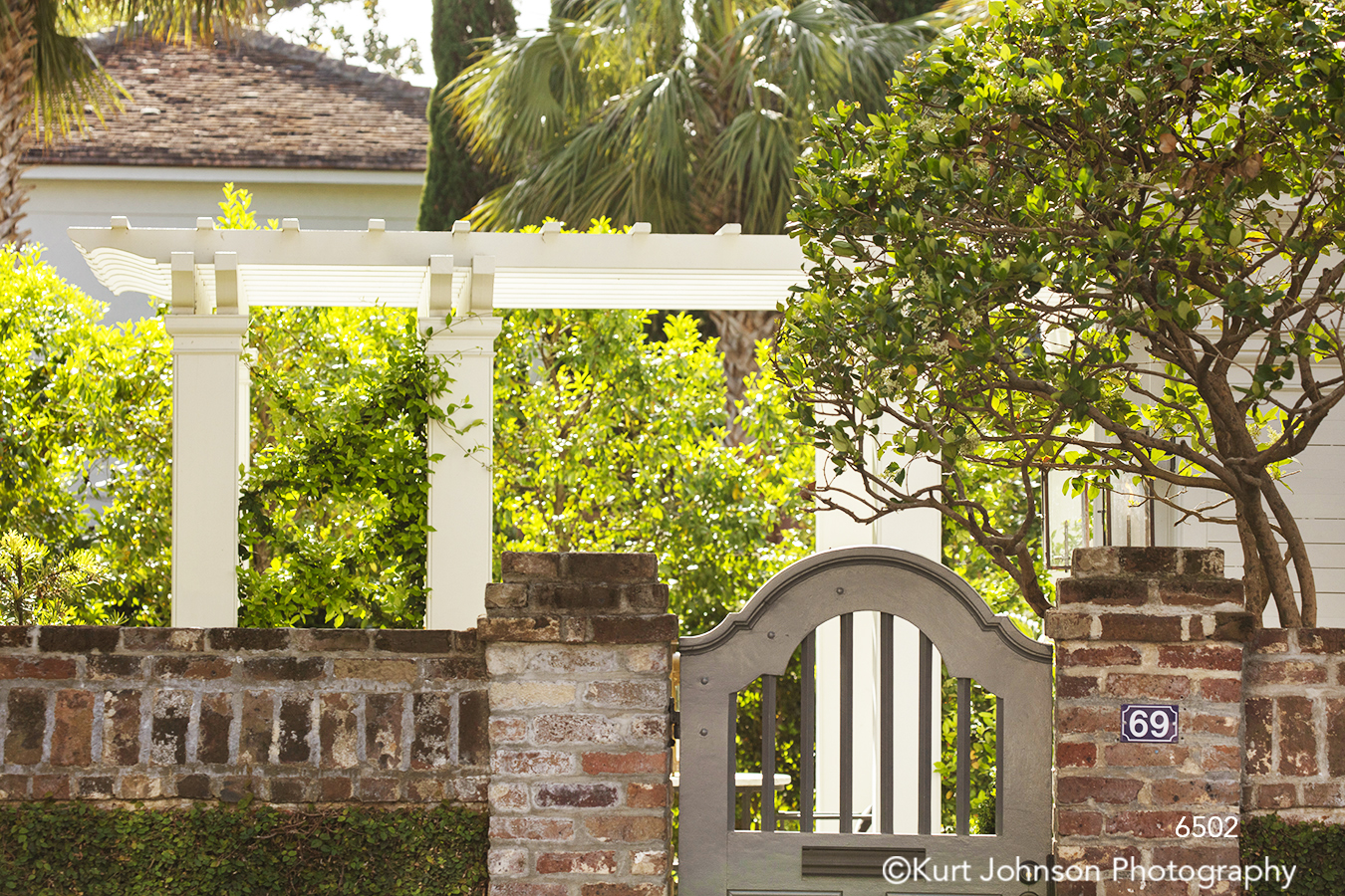 southeast Charleston South Carolina green tree trees red brick gate architecture city