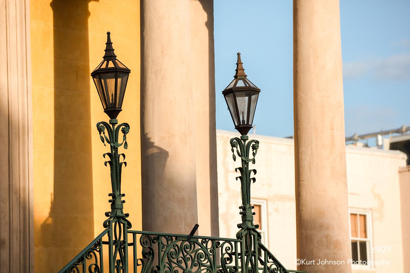 southeast Charleston South Carolina orange building blue sky architecture city lights black lamp posts