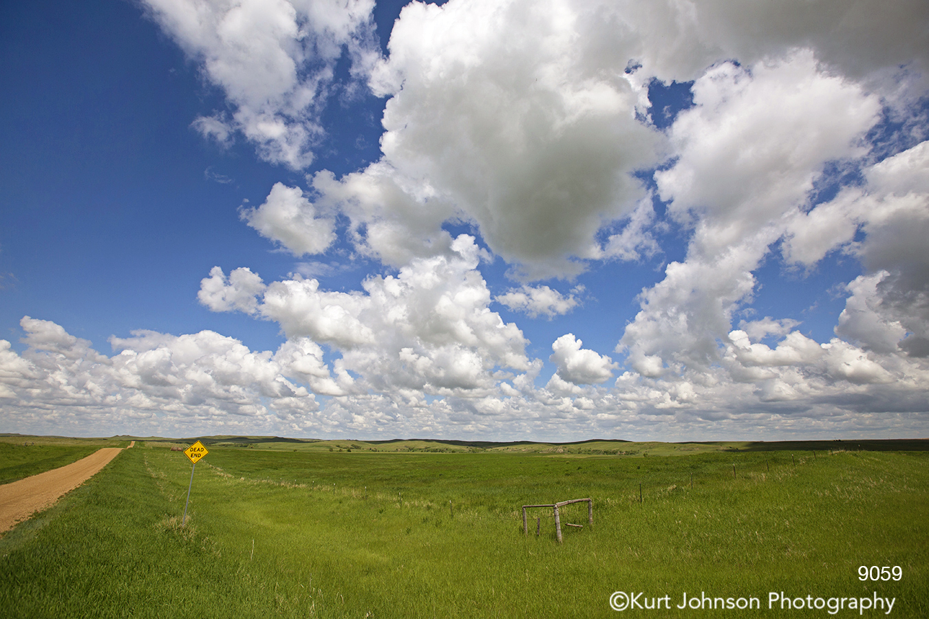 road path yellow sign blue sky clouds landscape country