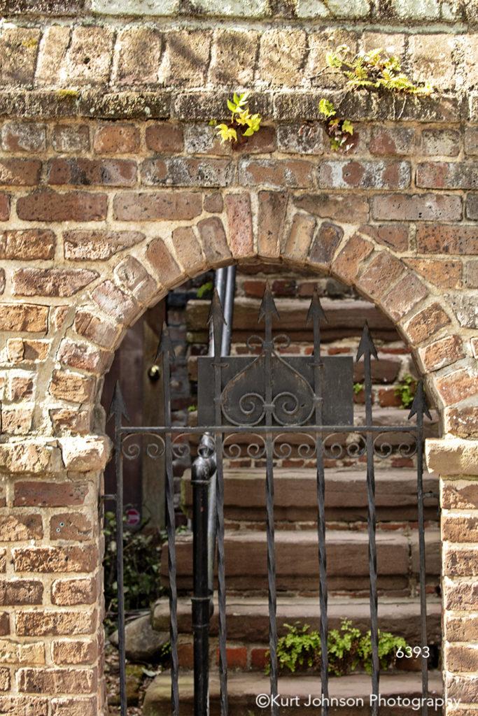 southeast charleston south carolina urban brick iron gate entry door path