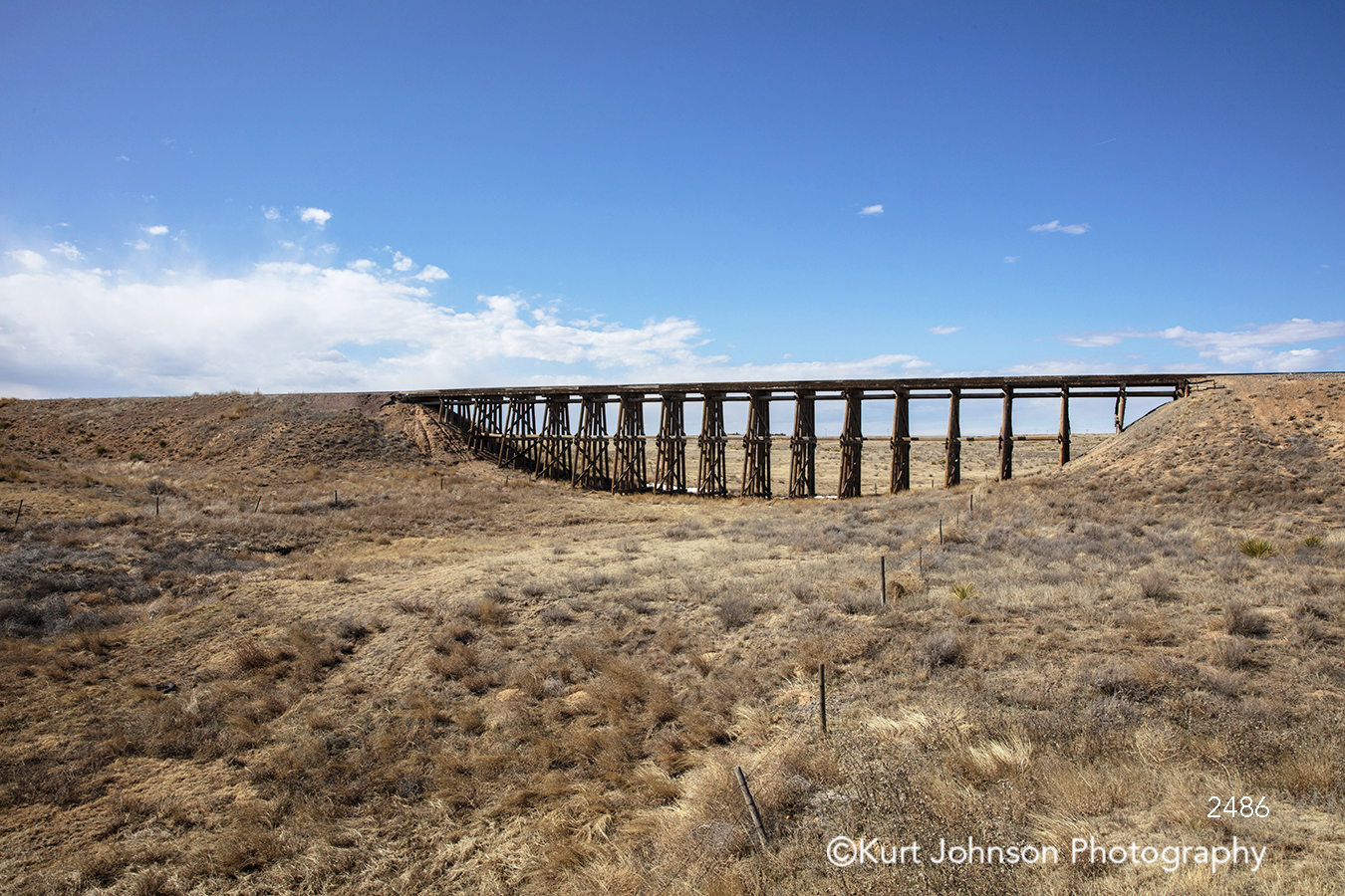 santa fe new mexico landscape bridge southwest desert blue sky clouds grass grasses