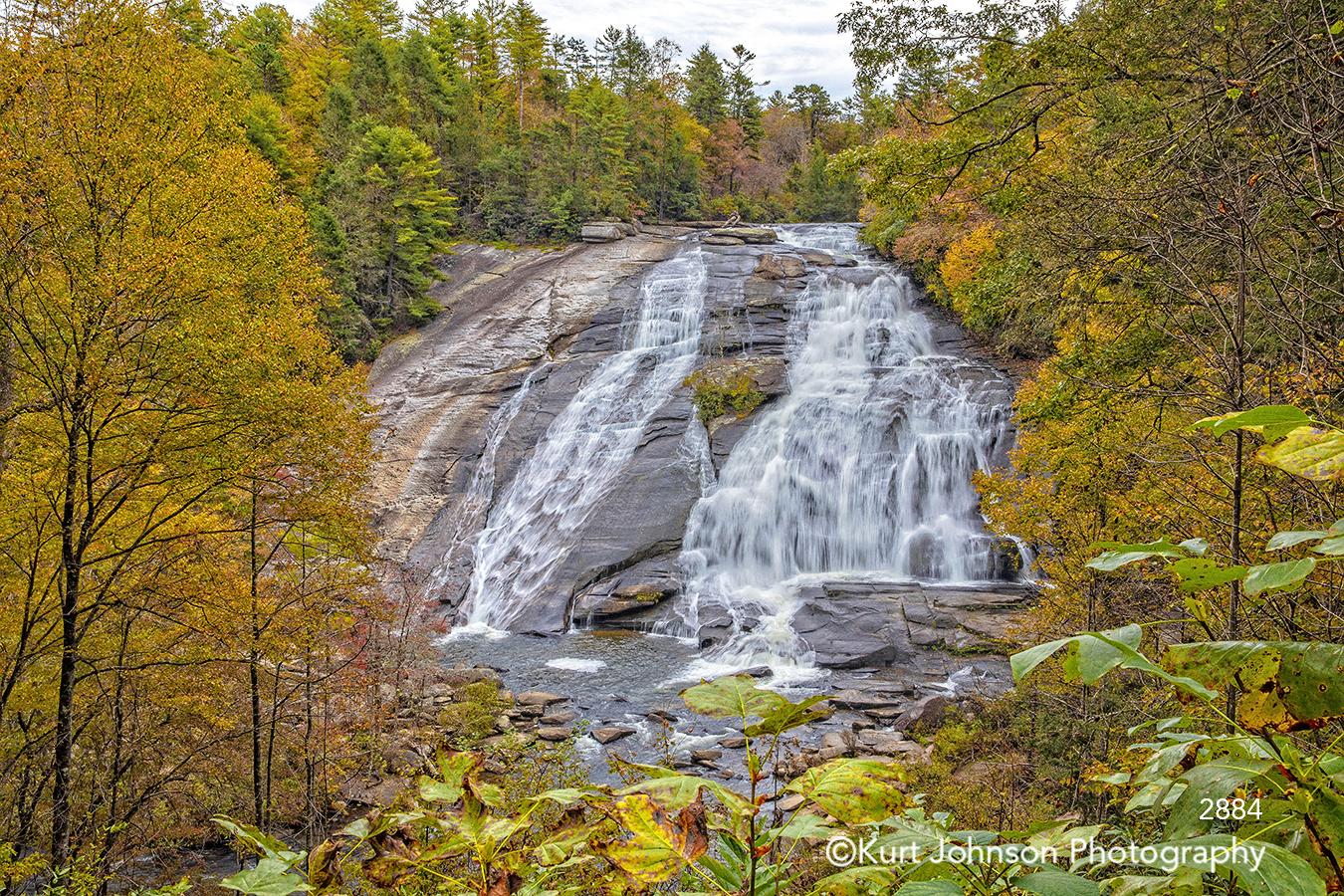 waterfall running water stream cliff mountain yellow gold orange green autumn fall brown rocks
