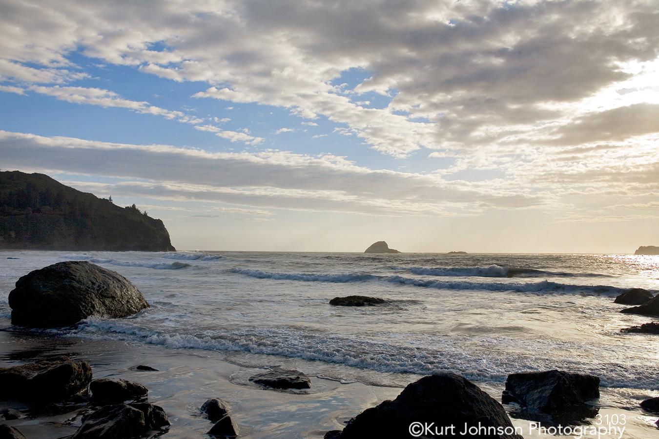 beach ocean rocks water waterscape blue sky clouds