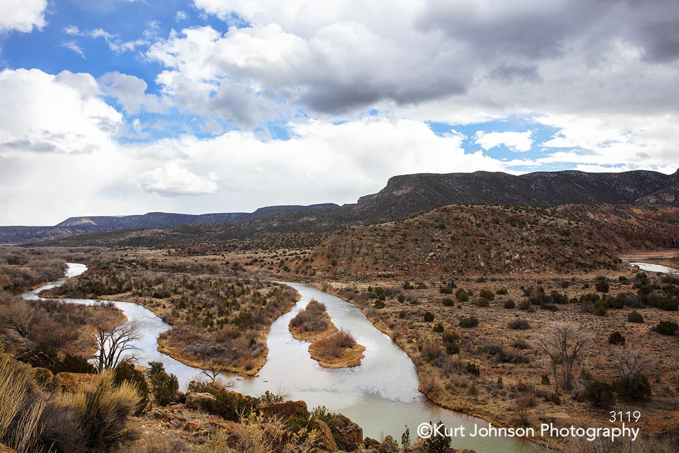 landscape southwest desert santa fe new mexico brown trees brush blue sky clouds indigenous