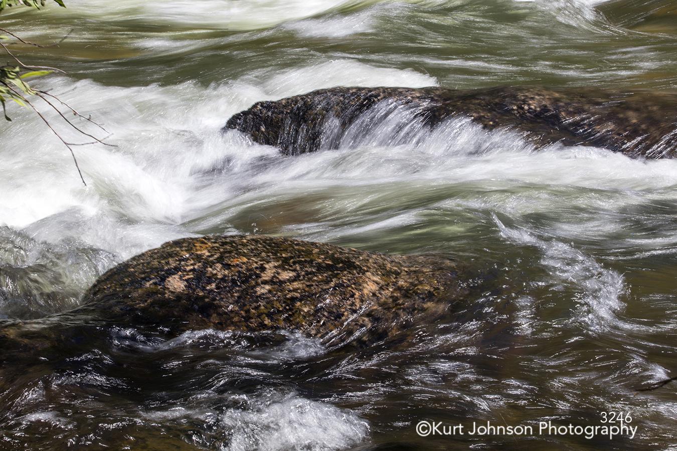 running water stream rocks waterscape