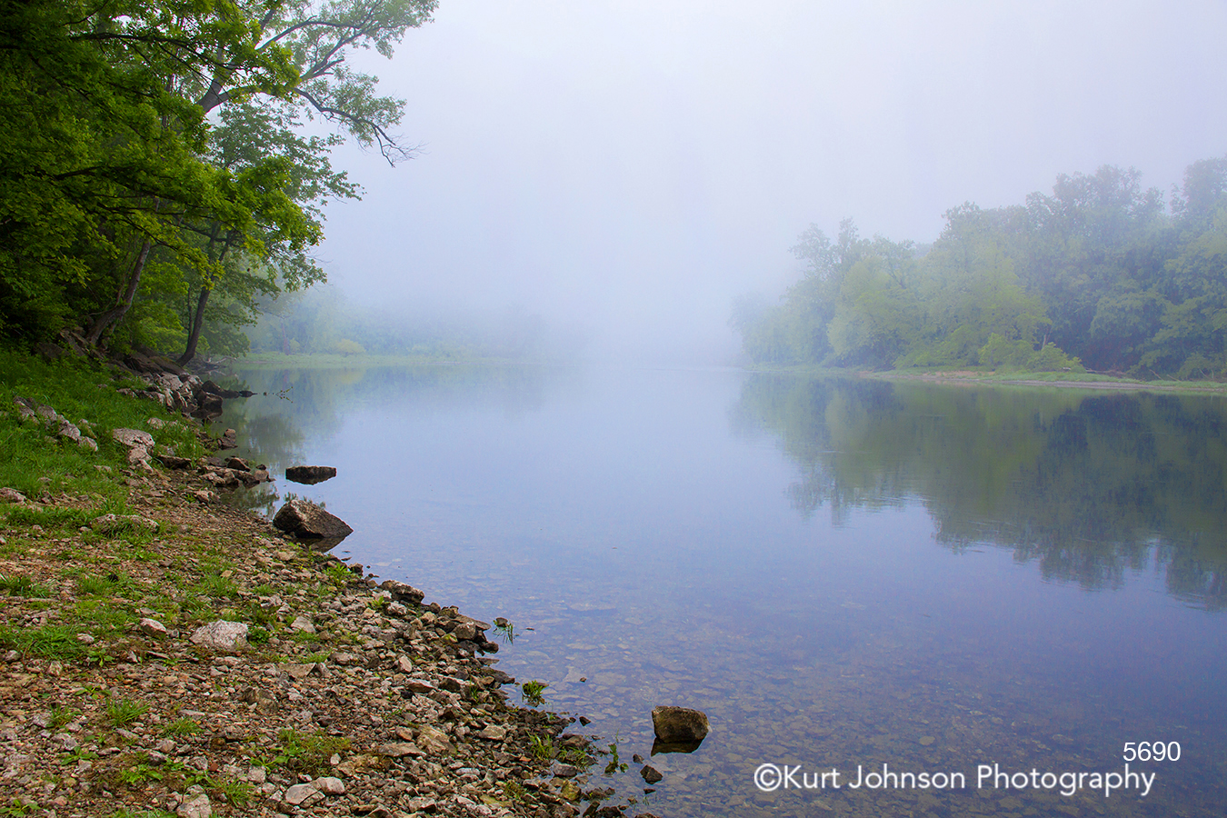 fog calm still water waterscape stream rocks shore green trees