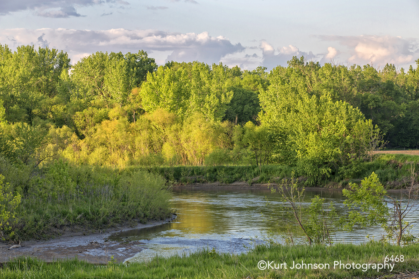 green yellow trees winding river stream calm still water landscape waterscape blue sky