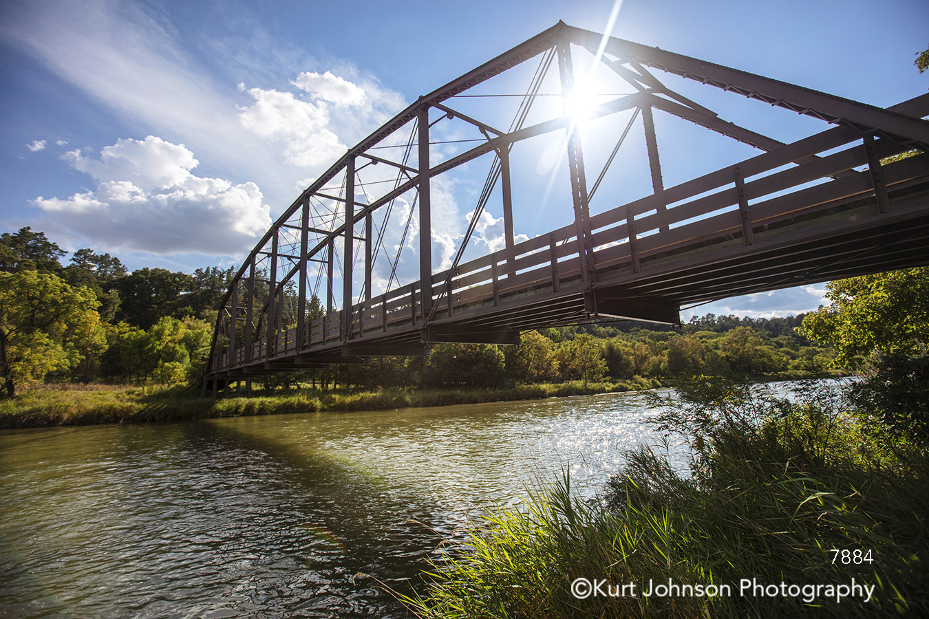 sun sunflare blue sky clouds brown metal bridge touchstone water waterscape lines river