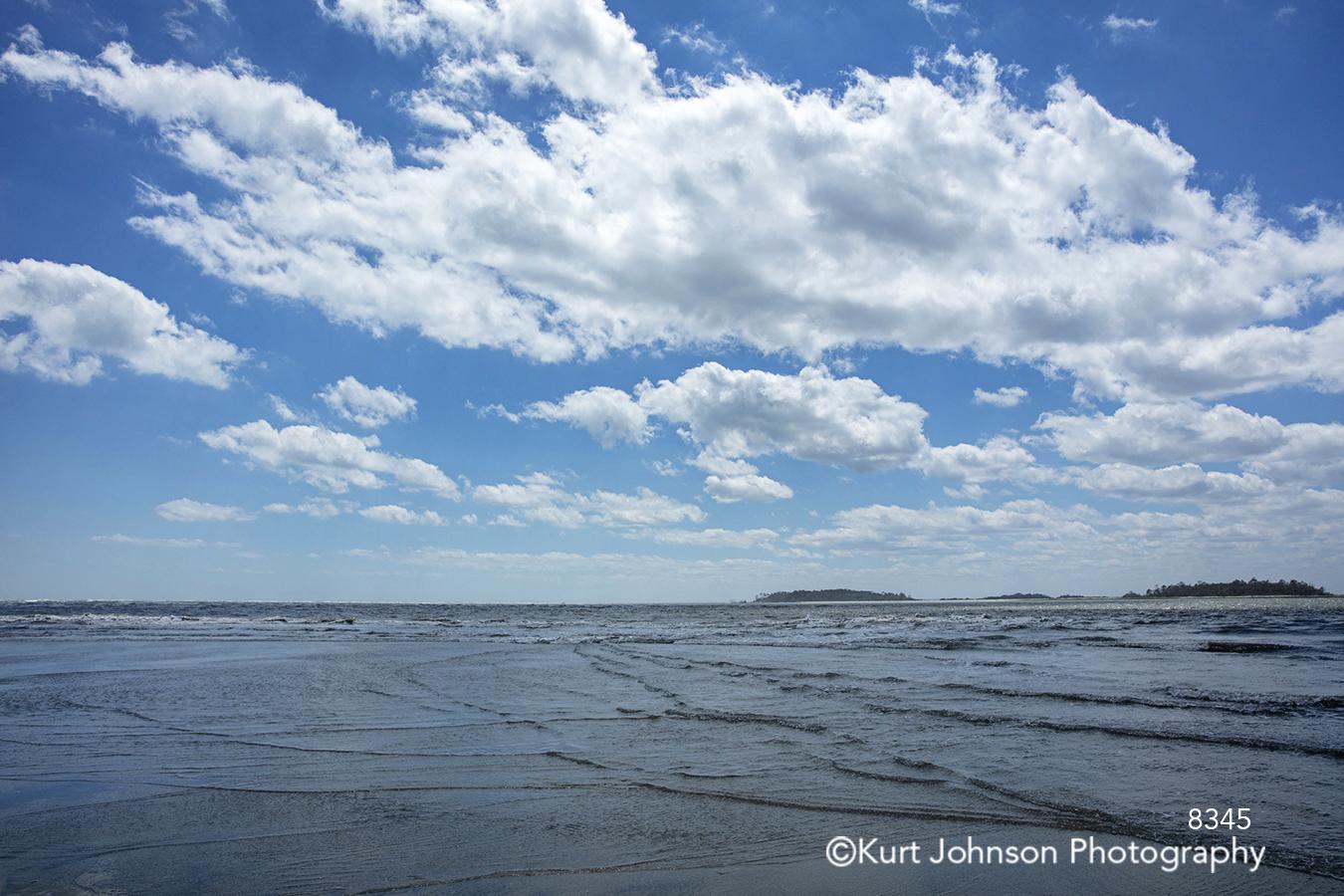 blue water waterscape sky white clouds ocean coast