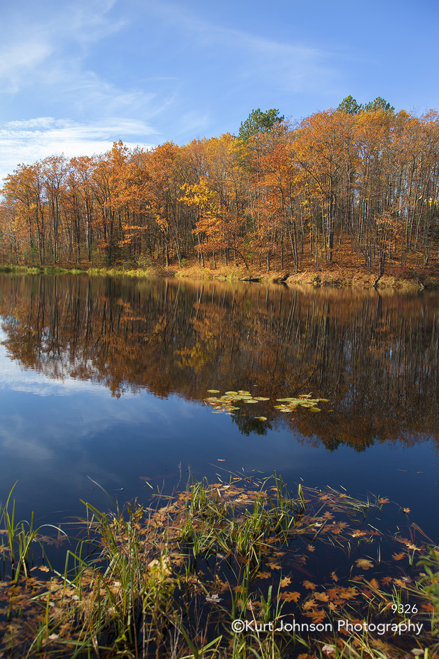 orange yellow autumn fall trees blue water reflection mirror sky clouds landscape waterscape