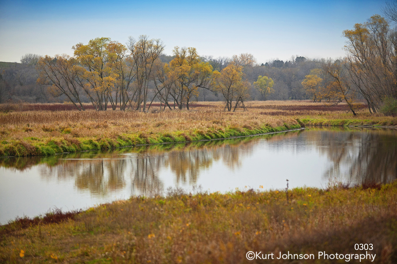 brown yellow green waterscape blue sky water midwest landscape trees field