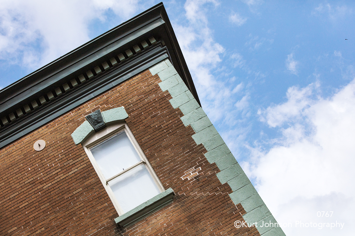 urban city brick building blue sky clouds south southeast downtown lines pattern texture modern