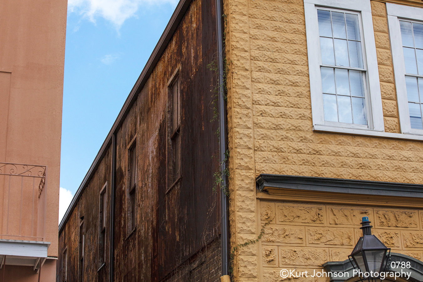 brown tan brick building downtown city blue sky clouds architecture historical south southeast