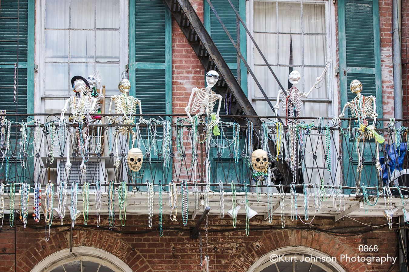 new orleans city downtown urban skeleton mardis gras building balcony