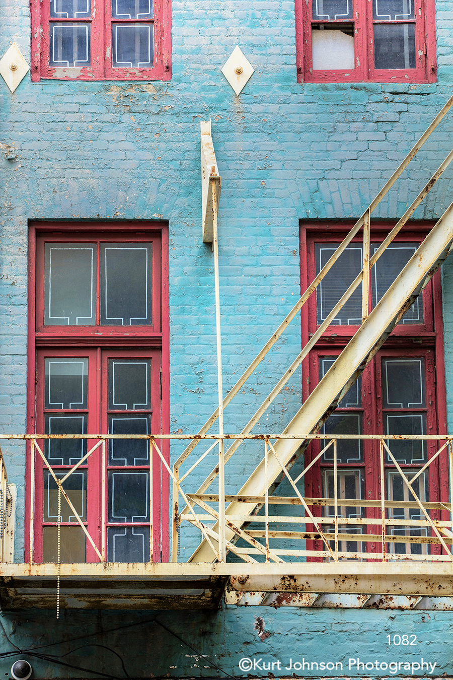 turquoise brick building windows colorful city staircase fire escape downtown architecture building south southeast
