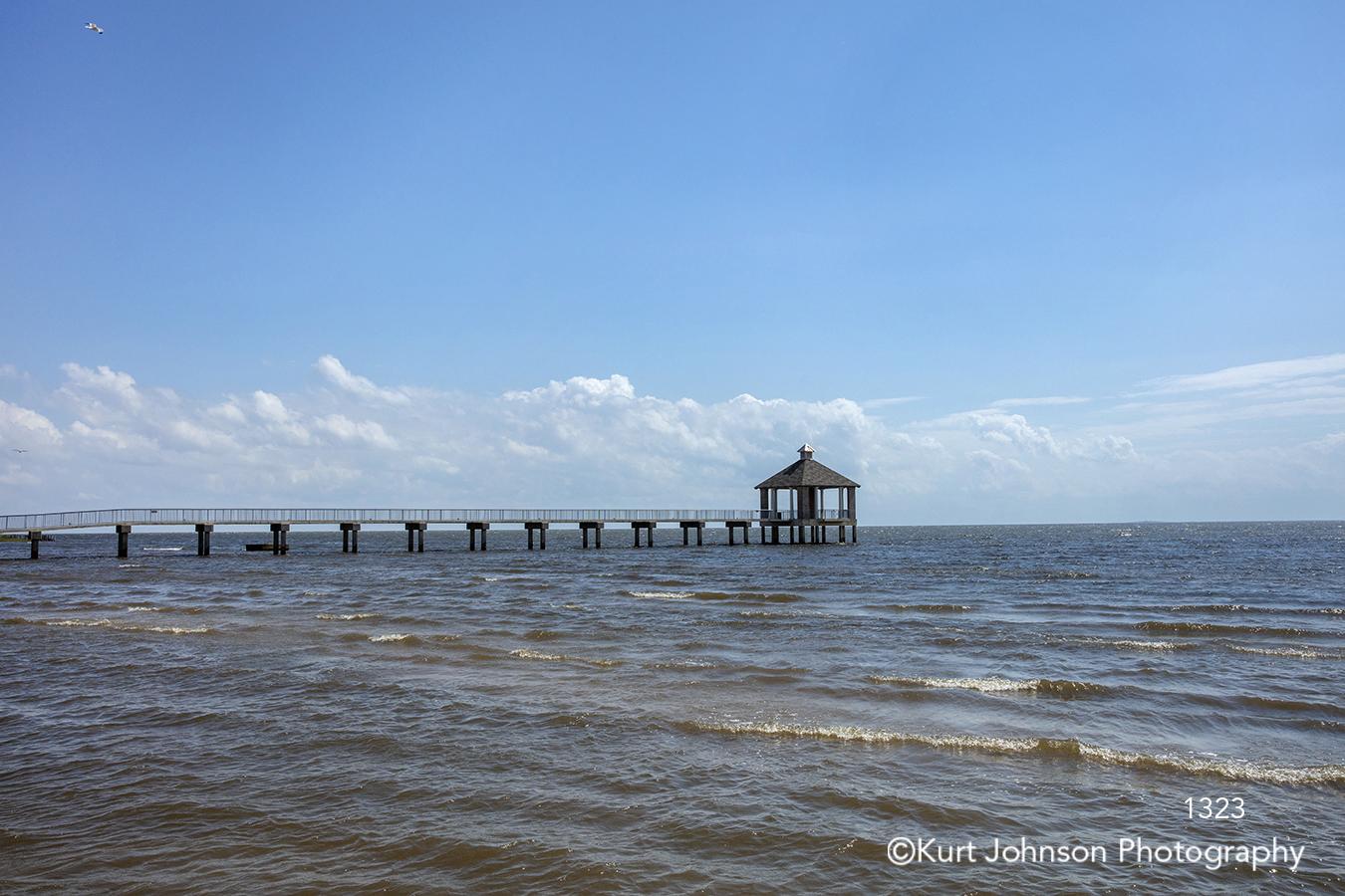 water pier waterscape waves calm blue boardwalk south southwest sky clouds